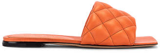 Bottega Veneta Leather Quilted Slides in Coral | FWRD