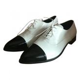 Prada White Leather Flats