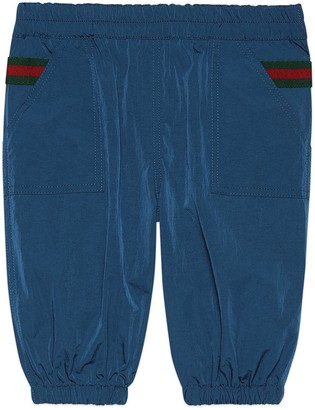 Gucci Baby nylon trousers with Web