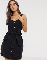 Asos DESIGN denim button pinafore mini dress in black