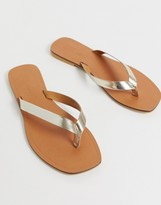 Asos DESIGN Florence leather flip flop sandals in gold