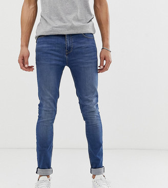 ASOS DESIGN Tall super skinny jeans in mid wash
