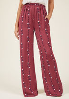 MCB1172 In these comfy pants, you've got 'flair' down to there and you aren't afraid to flaunt it! A fab look from our ModCloth namesake label, these berry-colored bottoms boast an elasticized waist, pockets, and loose legs patterned with white flowers 'n' blue v