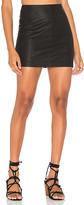 Free People Modern Femme Vegan Mini Skirt in Black. - size 10 (also in 2,4,8)