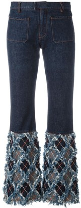 Jean Paul Gaultier Pre-Owned frayed bottom flare jeans