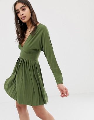 Asos Design DESIGN jersey crepe v neck mini dress with pleated skirt-Green