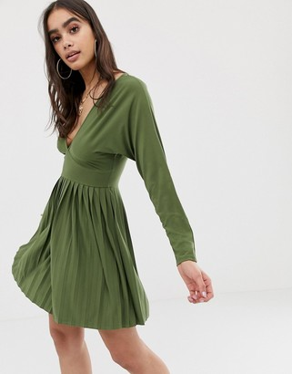Asos DESIGN jersey crepe v neck mini dress with pleated skirt
