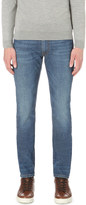 SLOWEAR Faded wash slim-fit tapered jeans