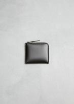 Comme des Garcons very black half zip wallet