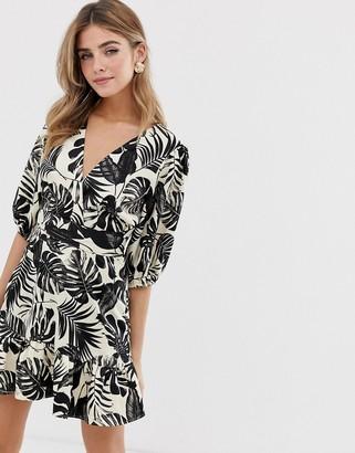 ASOS DESIGN wrap mini dress in mono tropical print