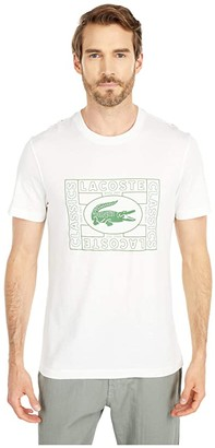 Lacoste Short Sleeve Solid Tee with Large Stamp Badge on Front Chest Stamp (Cake Flour White) Men's Clothing
