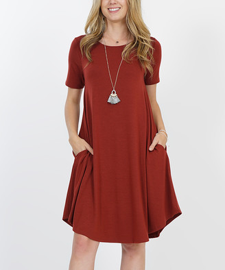 Lydiane Women's Casual Dresses FIREDBRICK - Fired Brick Crewneck Short-Sleeve Curved-Hem Pocket Tunic Dress - Women