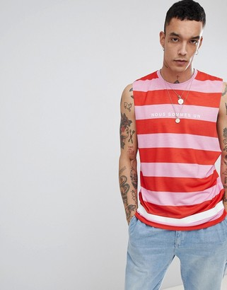 Asos Design DESIGN sleeveless t-shirt with dropped armhole with stripe and french text print-Pink