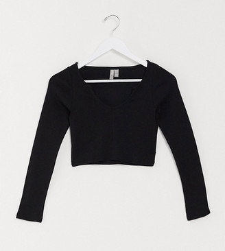 ASOS DESIGN Petite notch front long sleeve crop top in rib in black