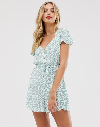 ASOS DESIGN frill sleeve romper with cut out back in animal print
