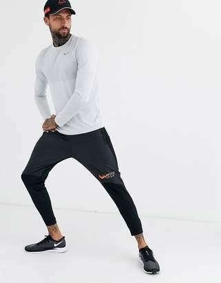 Nike Running Air Pack Phantom sweatpants in black