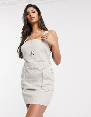 Calvin Klein Jeans logo utility dungaree dress in white