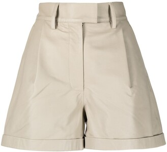 REMAIN Pleat-Detail Leather Shorts