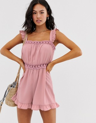 ASOS DESIGN playsuit with lace trim and ruffle hem