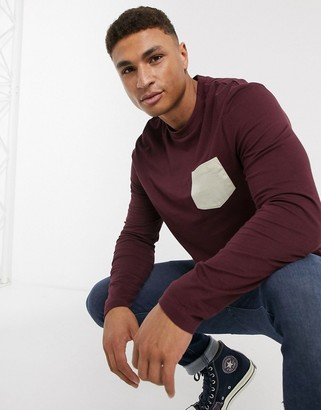 ASOS DESIGN organic long sleeve t-shirt with contrast pocket in burgundy