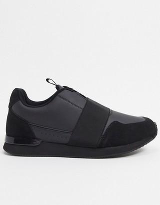 ASOS DESIGN sneakers in black with elastic strap