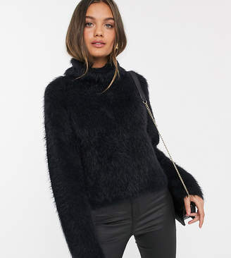 Vero Moda Petite roll neck fluffy jumper in black-White