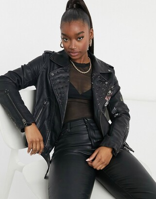 Blank NYC love and leave stud detail floral faux leather biker jacket in black