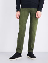 Saint Laurent Slim-fit tapered mid-rise jeans