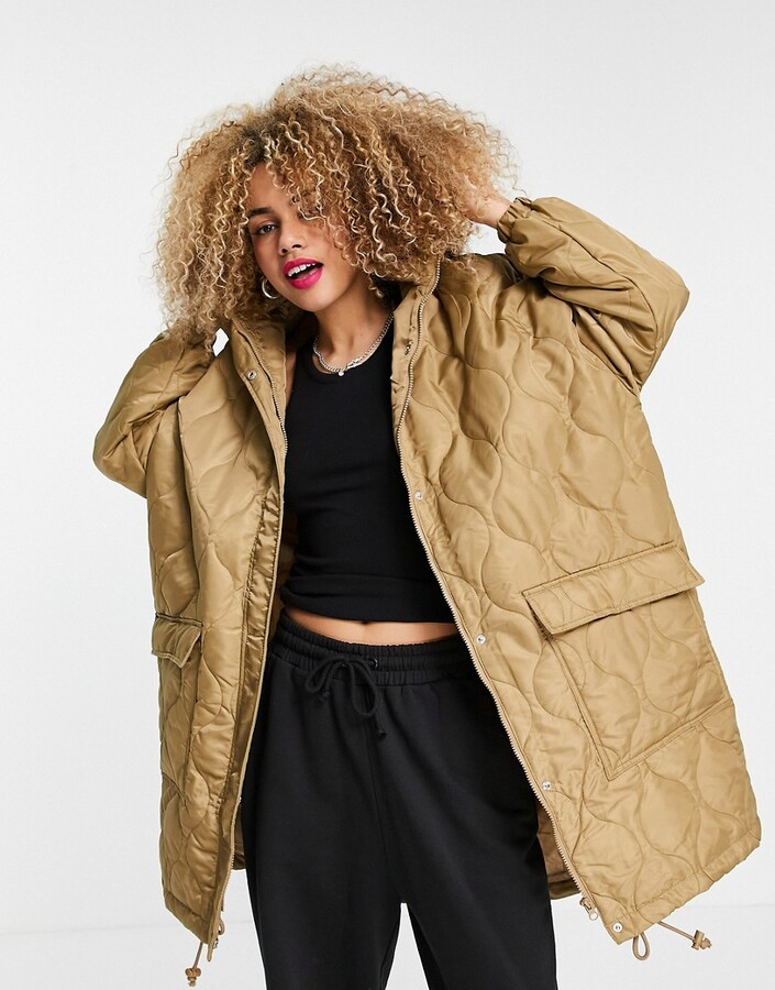 Thumbnail for your product : Collusion Unisex lightweight longline quilted jacket in beige