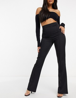 Femme Luxe flared pants in black