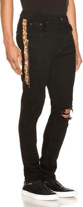 Amiri Leopard Half Track Broken Denim Jean in Black & Leopard | FWRD