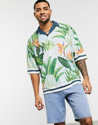 ASOS DESIGN oversized revere collar polo with all over floral print