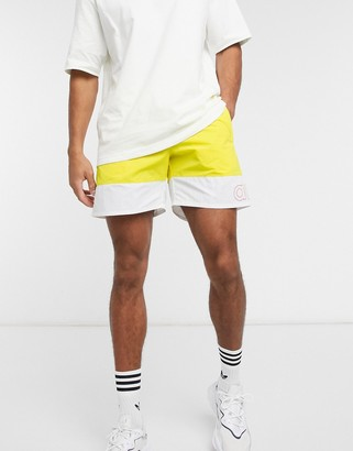 adidas Pride shorts in yellow