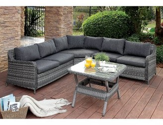 Red Barrel Studio Annetta Hollister 4 Piece Rattan Sectional Seating Group with Cushions