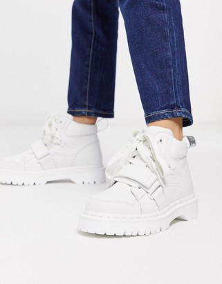 Dr. Martens Zuma with buckle strap flat ankle boots in white