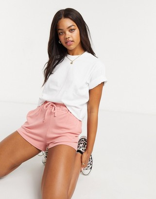 In The Style X Saffron Barker runner shorts in pink co ord