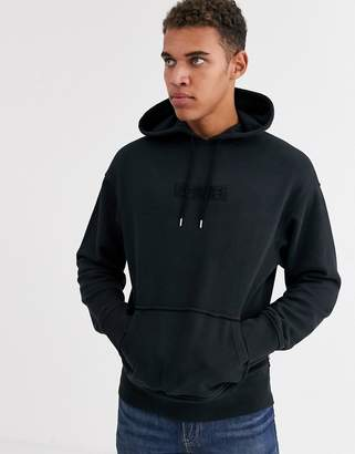 Levi's embroidered tonal babytab logo relaxed fit hoodie in mineral black