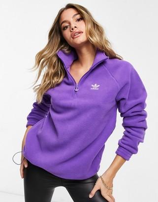 adidas logo quarter zip fleece top in purple