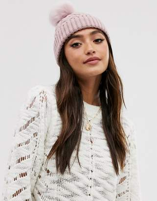 Asos Design DESIGN cable faux fur pom beanie hat in recycled polyester in pink