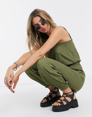 Bershka crinkle elasticated waist jumpsuit in khaki