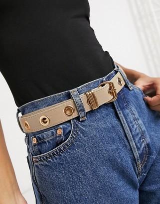 ASOS DESIGN eyelet jeans waist and hip belt in beige