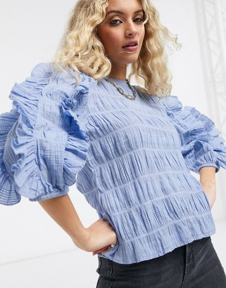 Object textured blouse with ruffles in blue