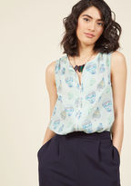 Mct1103D Even a late night in the studio deserves your best style effort. Show you agree by sporting this mint top to record your next episode! Boasting a pastel hot air balloon print, a notched neckline, and ivory trim down the center, this loose 'n' flowy ModClo