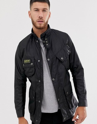 Barbour International slim wax jacket with pocket detail in black