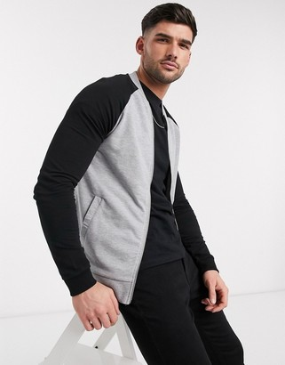 ASOS DESIGN muscle jersey bomber jacket in gray marl with black raglan sleeves