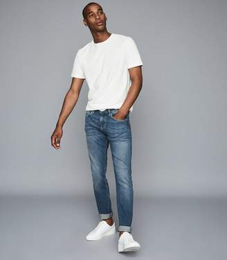 Reiss Ceha - Tapered Slim Fit Jeans in Washed Indigo