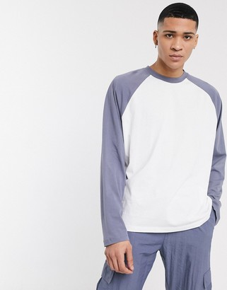 ASOS DESIGN oversized long raglan t-shirt with contrast sleeves in white and grey