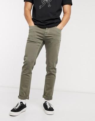 ASOS DESIGN stretch slim jeans in green