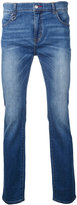 GUILD PRIME logo print jeans - men - Cotton/Polyurethane - 0