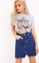 PrettyLittleThing Hanele Mid Wash Fray Hem Denim Mini Skirt